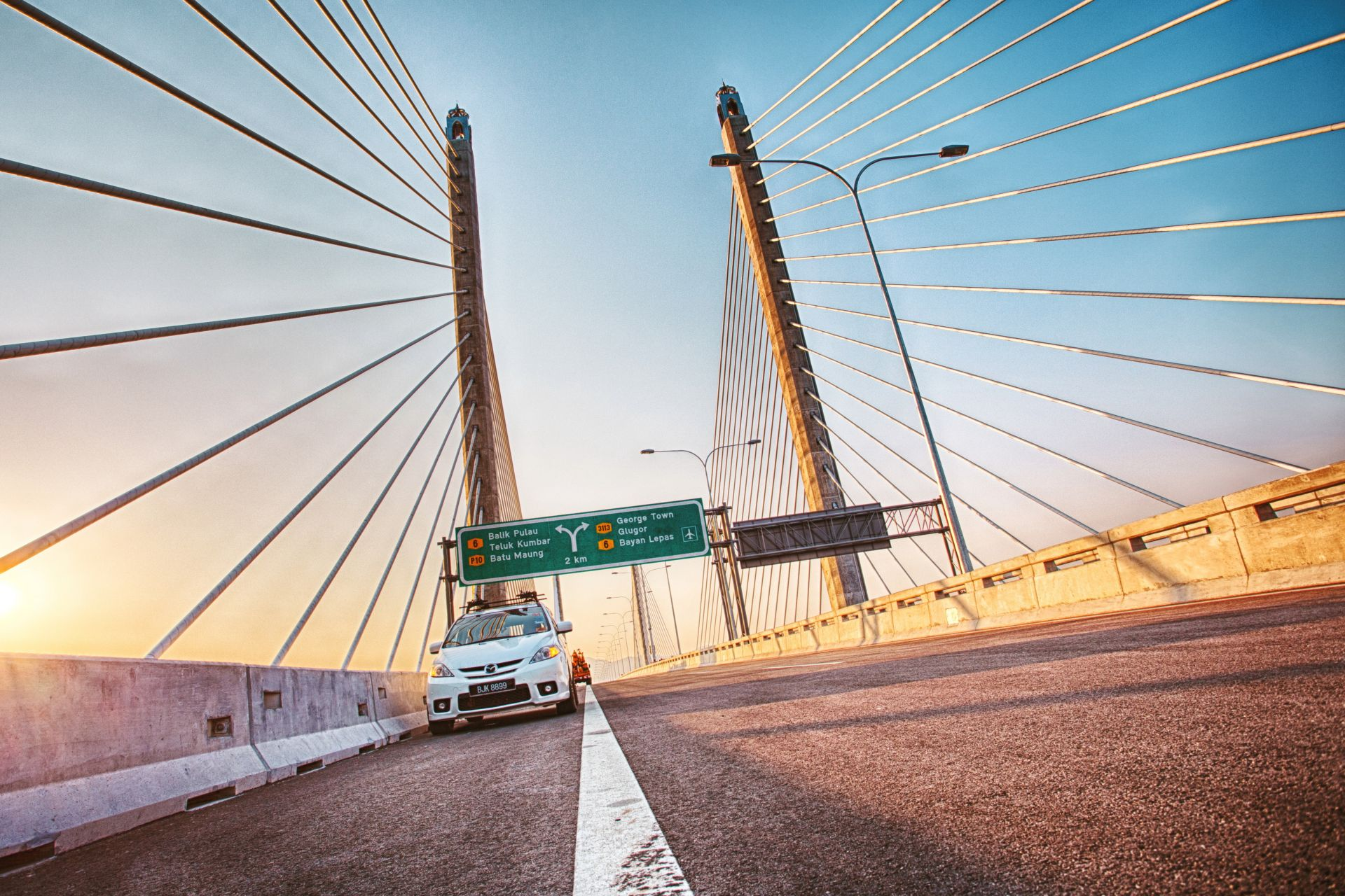 White car on Second Penang Bridge in Malaysia