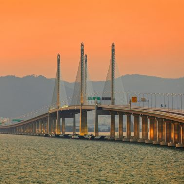 Orange sunset sky over Second Penang Bridge in Malaysia
