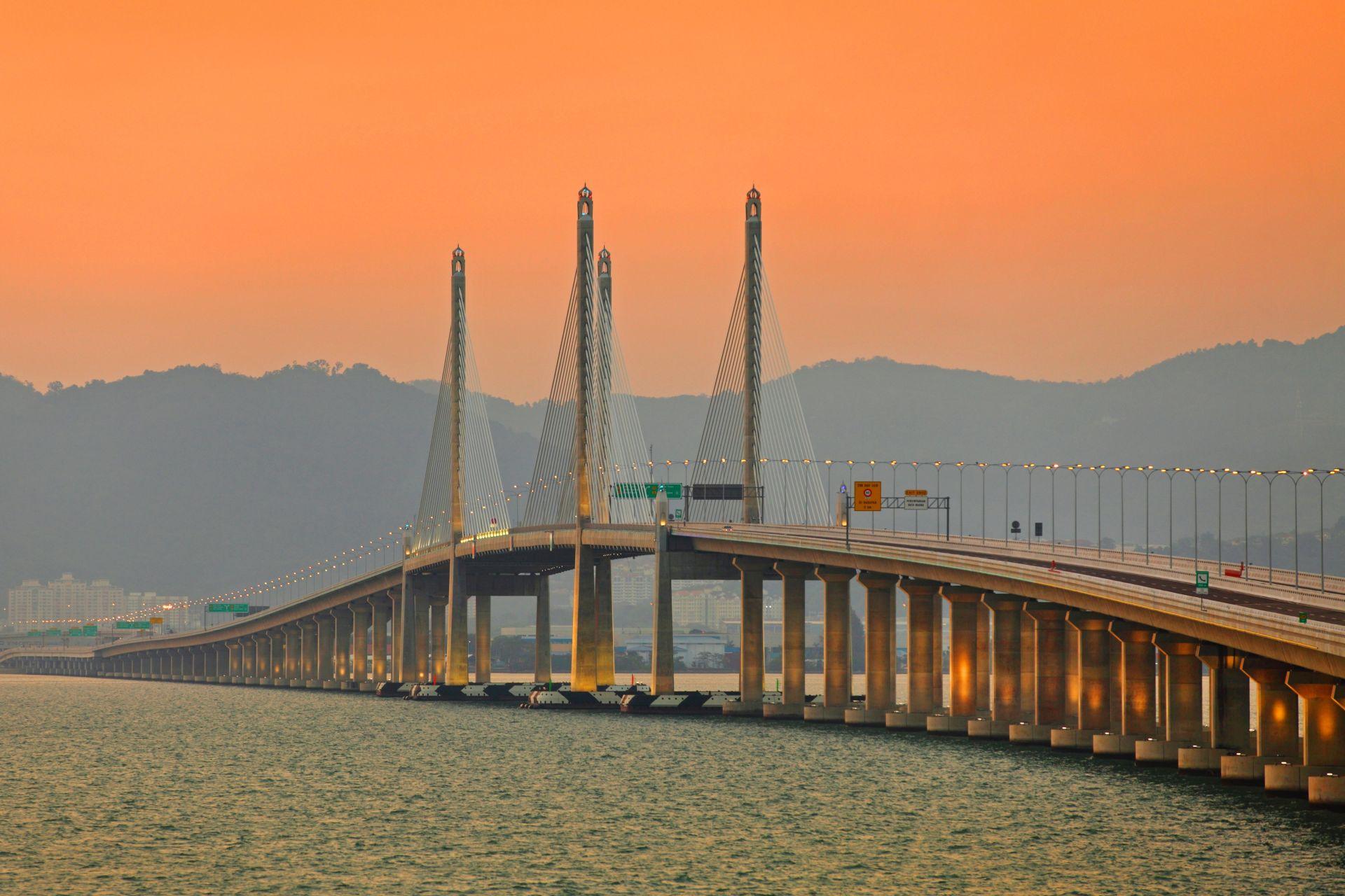 Orange sunset sky over Second Penang Bridge in Malaysia