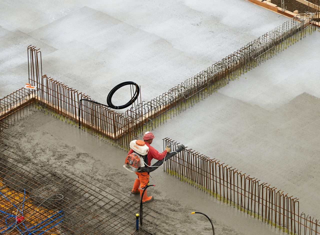 Man applying concrete on construction site with Sika® Antisol® curing compound