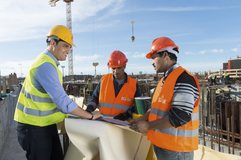Sika engineer consulting workers on construction site in Morocco