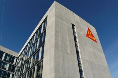 Architectural concrete facade on Sika office building with weather joint sealing glazing