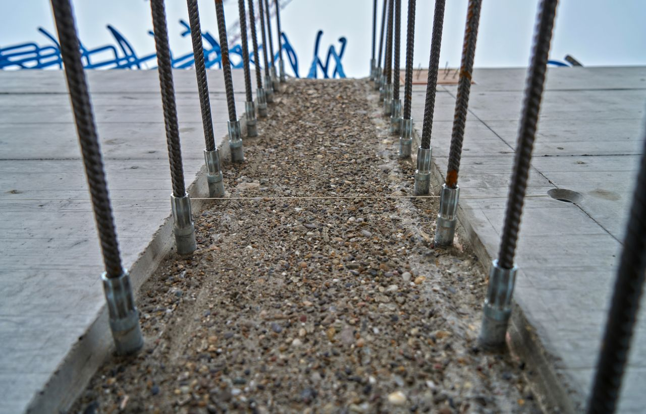 Sika® Rugasol® surface retarder applied to concrete for exposed aggregate reinforcement on construction site