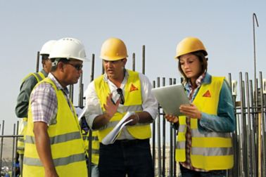 Sika technical experts advising specifier on construction site