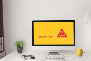 Sika desktop computer with webinar screen and Sika logo