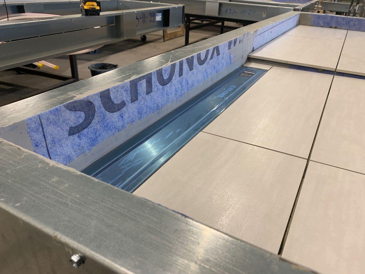 A Schönox waterproofing system installed in a bathroom pod