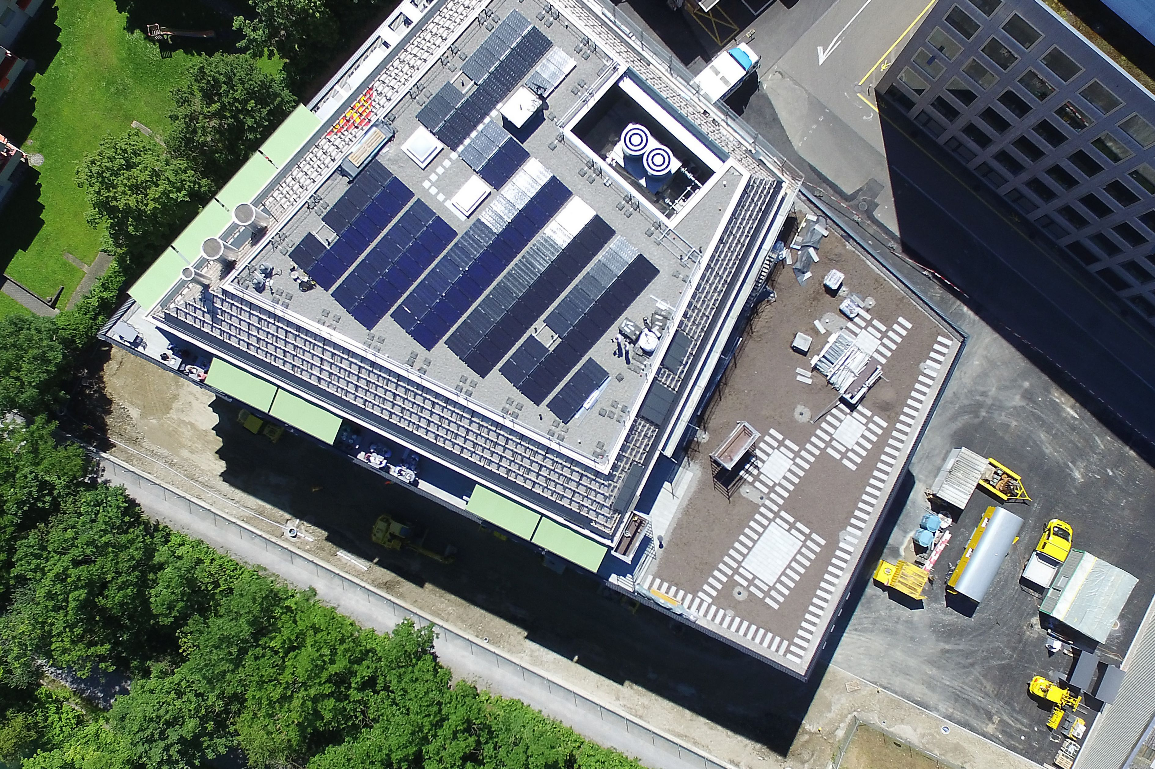 Solar PV panels mounted to roof at Limmat building in Zurich drone view