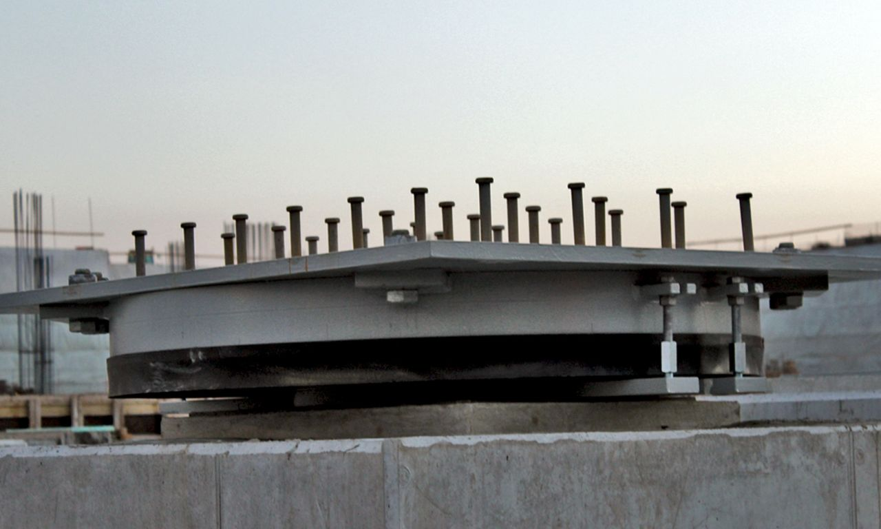 Seismic isolation system with cementitious grout for the Stavros Niarchos Foundation Cultural Center
