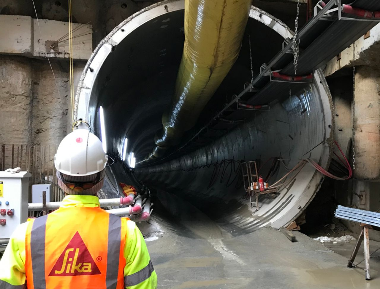 Sika engineer standing next to tunnel boring machine in tunnel construction