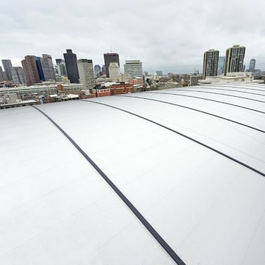 Cool roof with reflective Sikalastic liquid applied membrane installed on TD Garden in Boston in USA