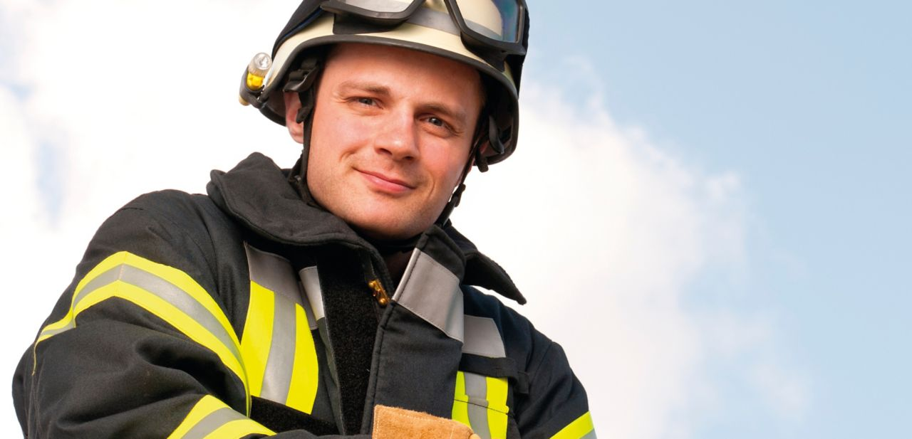 A sitting fireman wearing technical textile bonded with SikaMelt