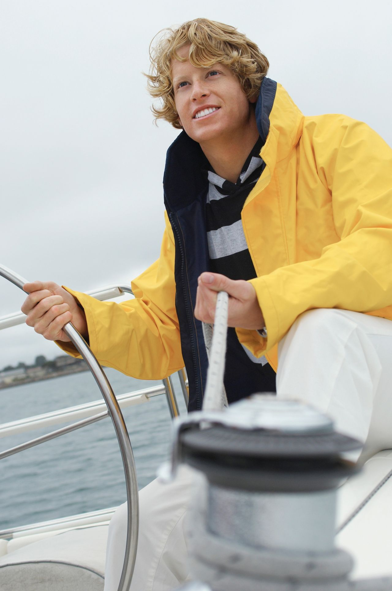 A fisherman holding a rope and wearing functional textile containing SikaMelt glue