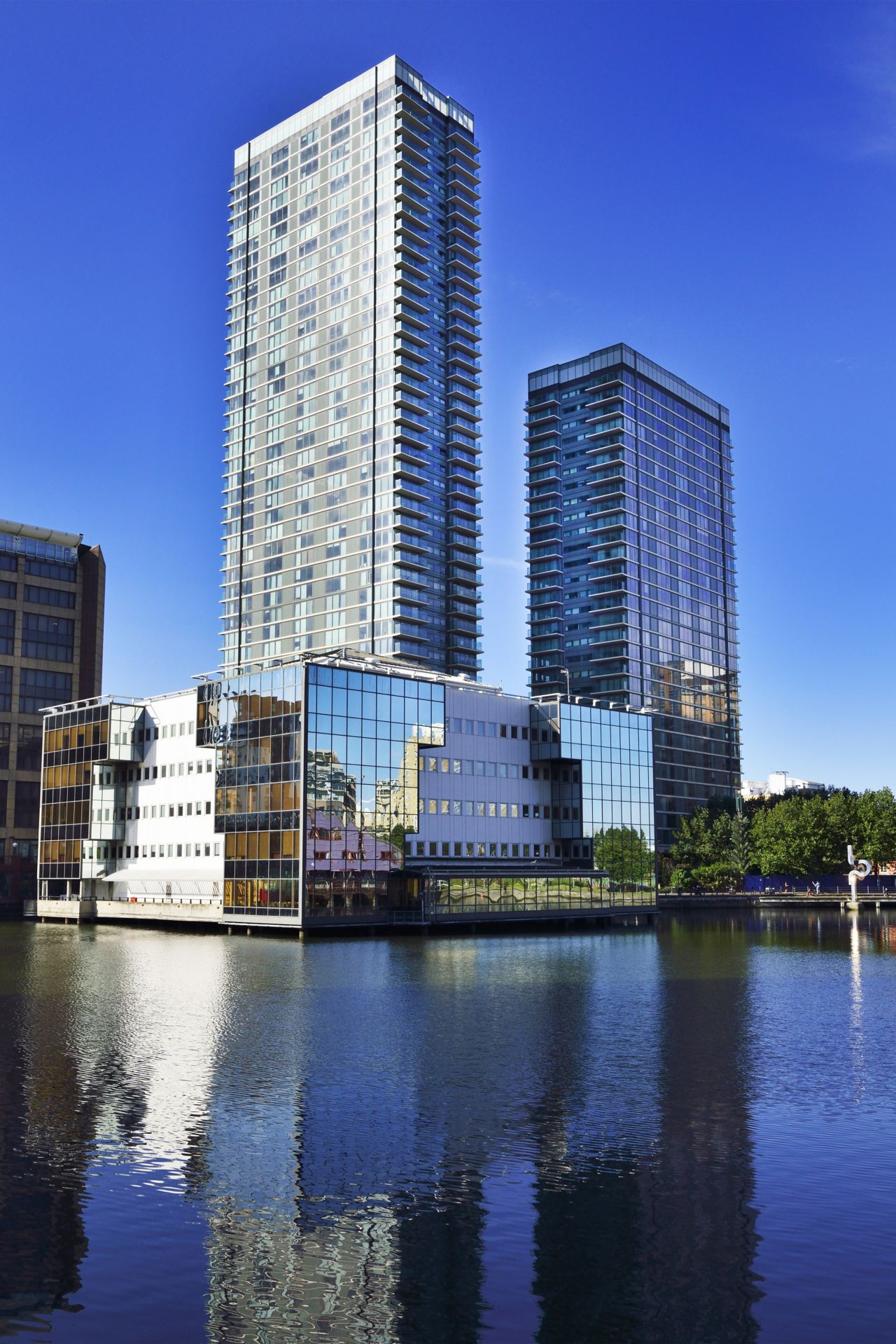 High rise buildings in front of a lake