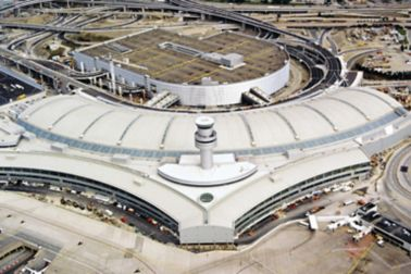 Single-ply roof PVC membrane of Sarnafil mechanically fastened system installed on Toronto Pearson International Airport in Canada