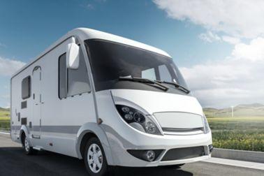 A caravan driving on the street