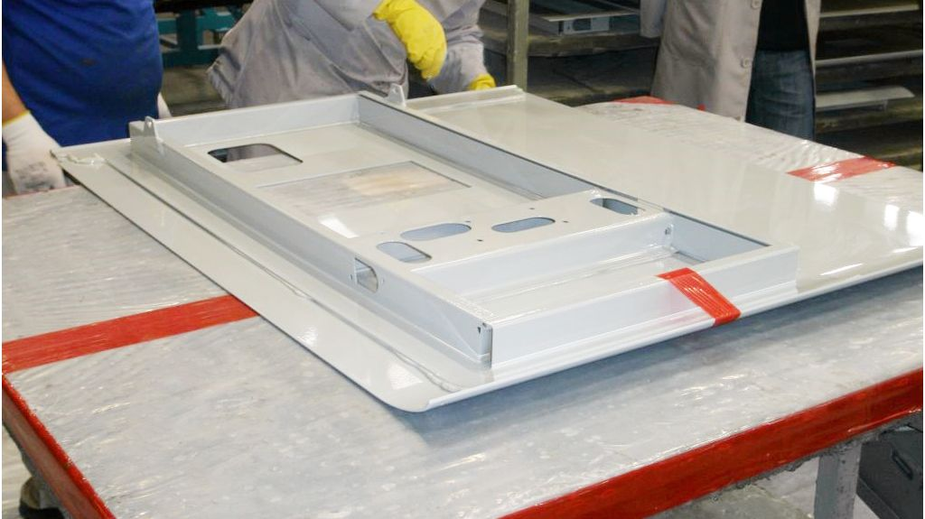 Adhesive bonding on a metal panel