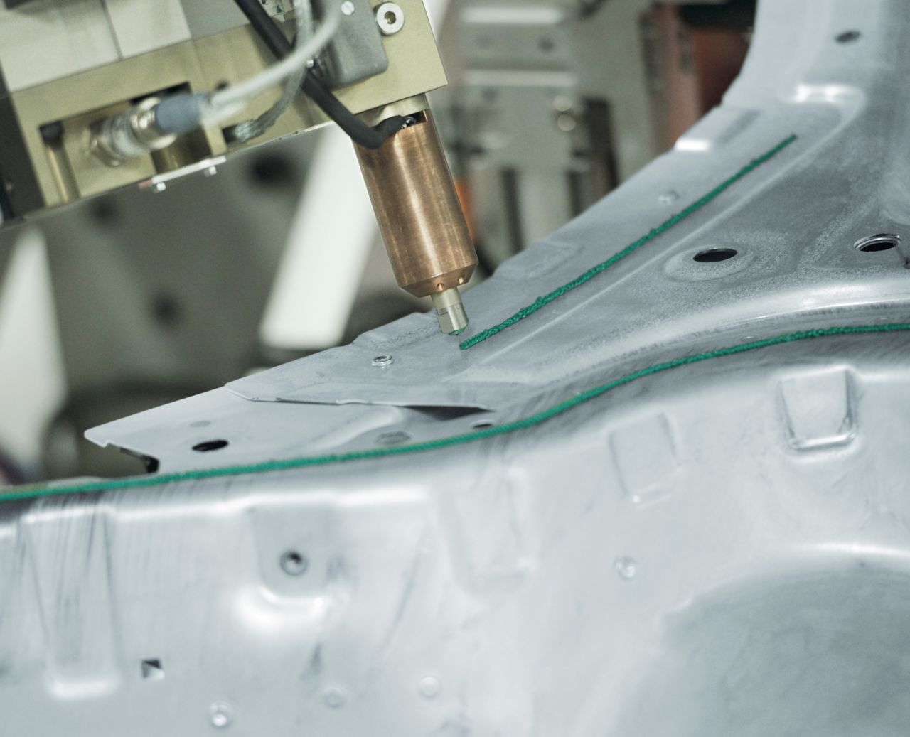 Metaallijmbinding met robottoepassing