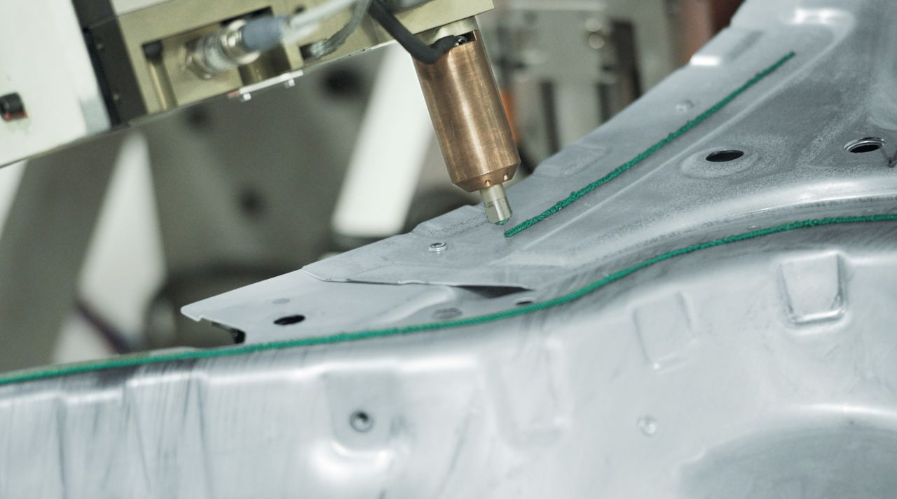 Metal adhesive bonding with robot application