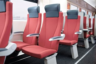 Inside of a railway with floor and seats