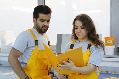 Gizem and Abduallah reading a brochure