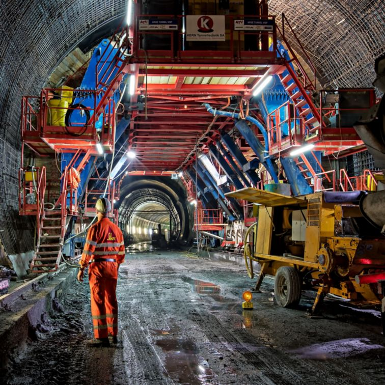 Worker at construction site inside tunnel in Vips Valley in Switzerland