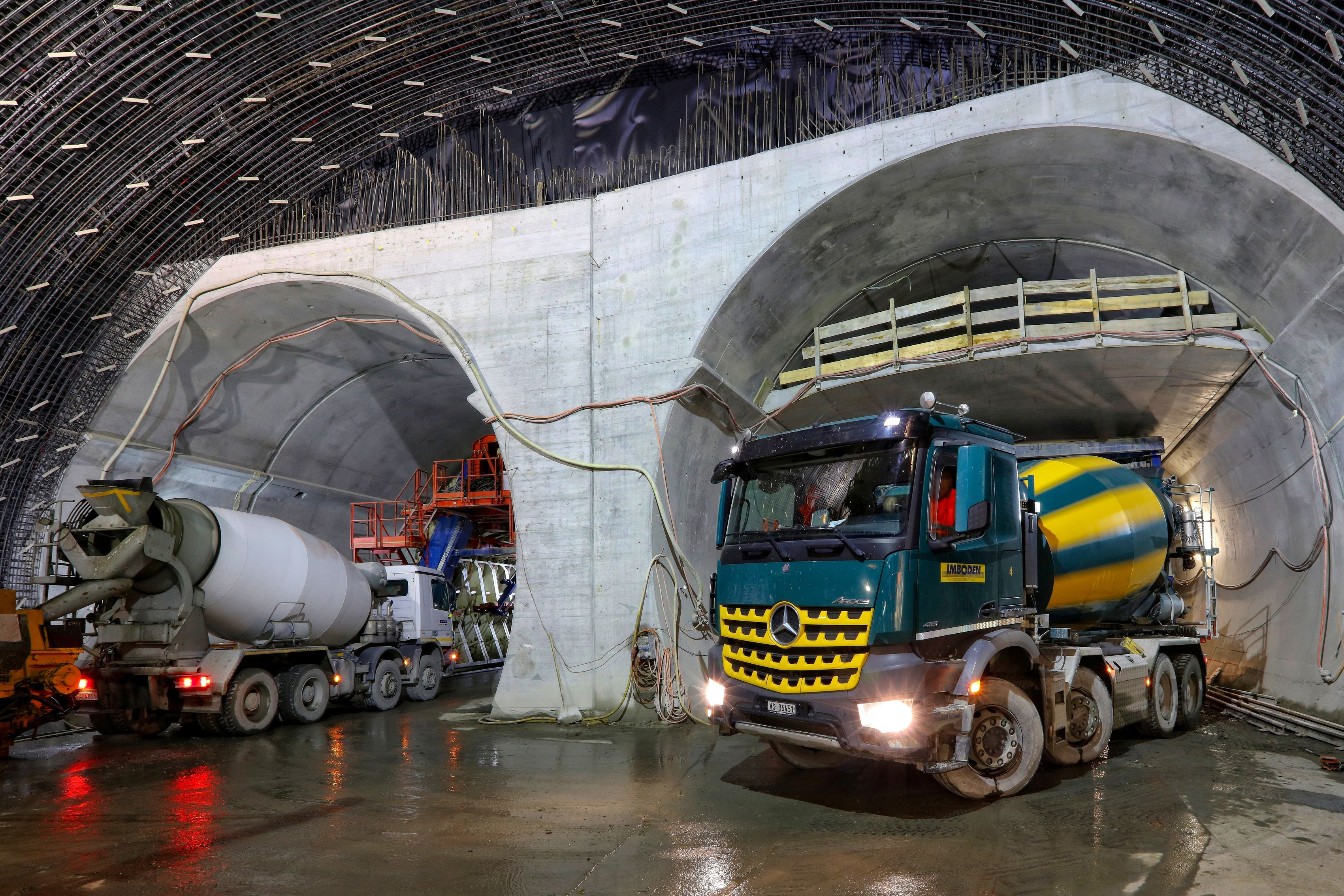 Concrete mixer trucks at construction site of Visp tunnel in Switzerland