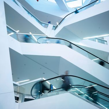 People on escalators inside Westside Shopping and Leisure Centre in Bern