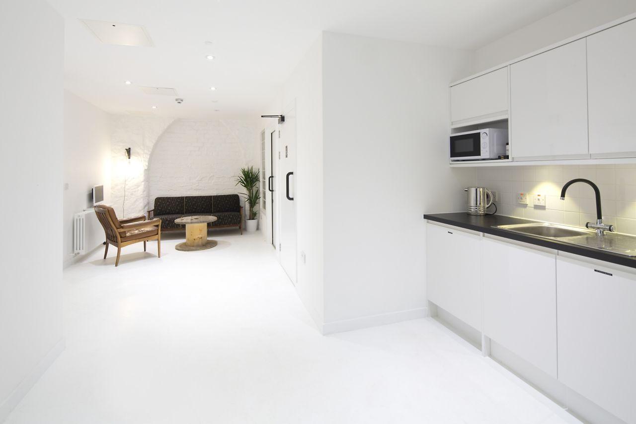 Sika ComfortFloor® white floor in completely white interior of home kitchen