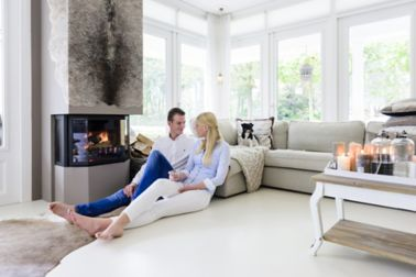 Sika ComfortFloor® white floor in fireplace living room with couple sitting on floor