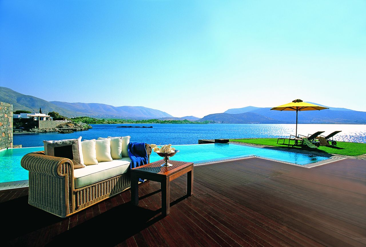 Wood floor installed by an infinity swimming pool