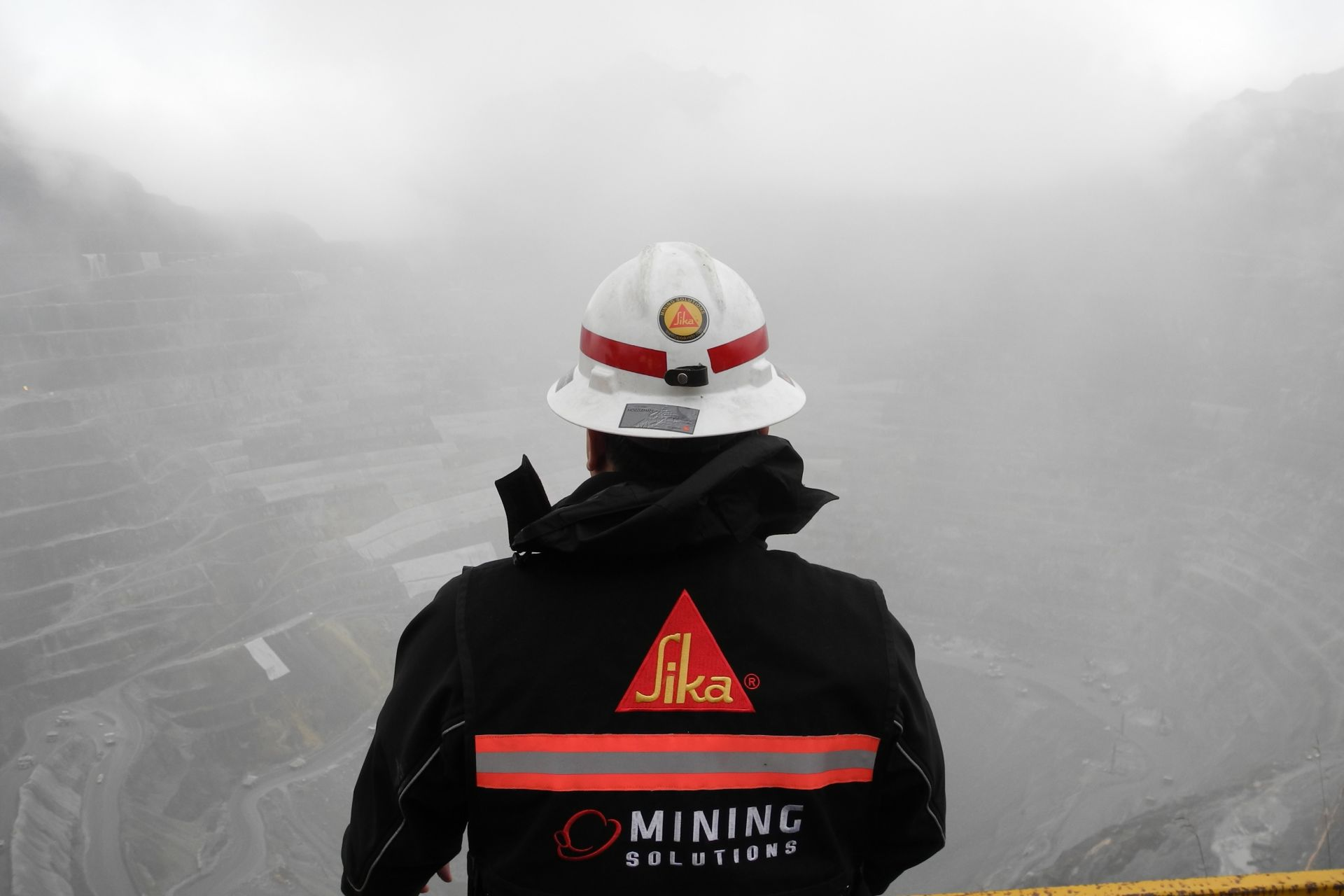 Sika worker looking at the Grasberg Copper-Gold Mine