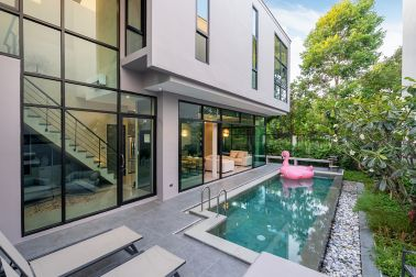 exterior home with swimming pool in the house