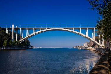 View of the Douro River mouth and the Arrabida Bridge in a beautiful early spring day at Porto City in Portugal