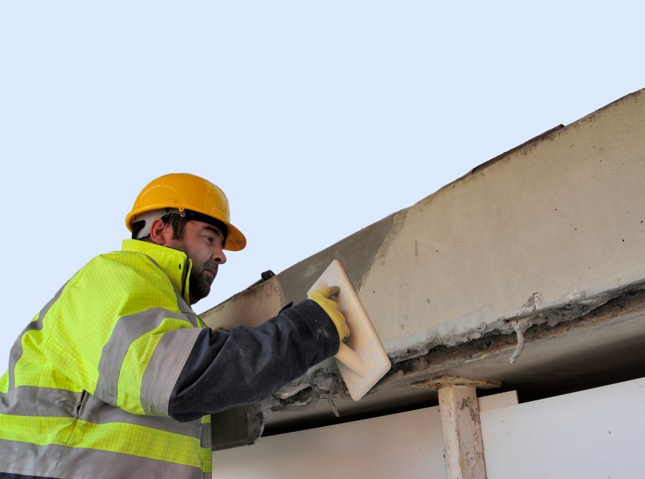Man repairing concrete bridge with Sika repair mortar