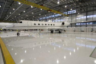 Airplane inside an airport hangar