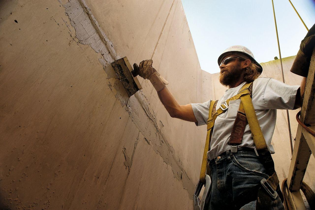 Man applying concrete repair mortar at Hoover Dam bypass bridge project