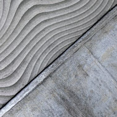 Architectural textured concrete wall produced with Sika concrete admixtures at Limmat building in Zurich