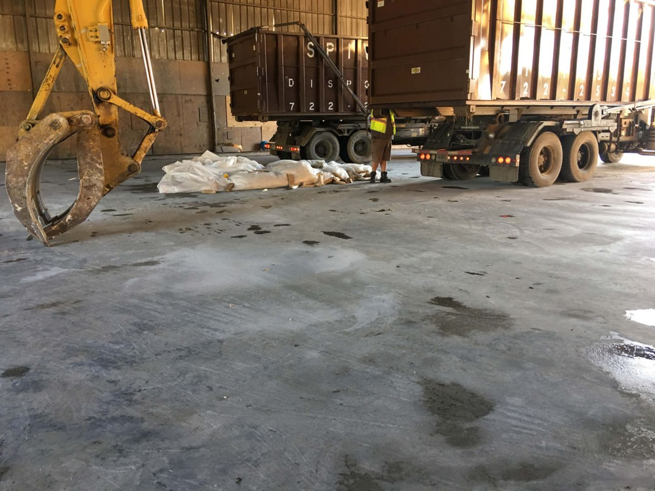 Construction Equipment Breaking Concrete Slab