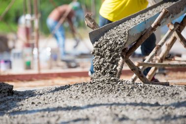 Concrete pouring during commercial concreting floors of buildings in big construction site