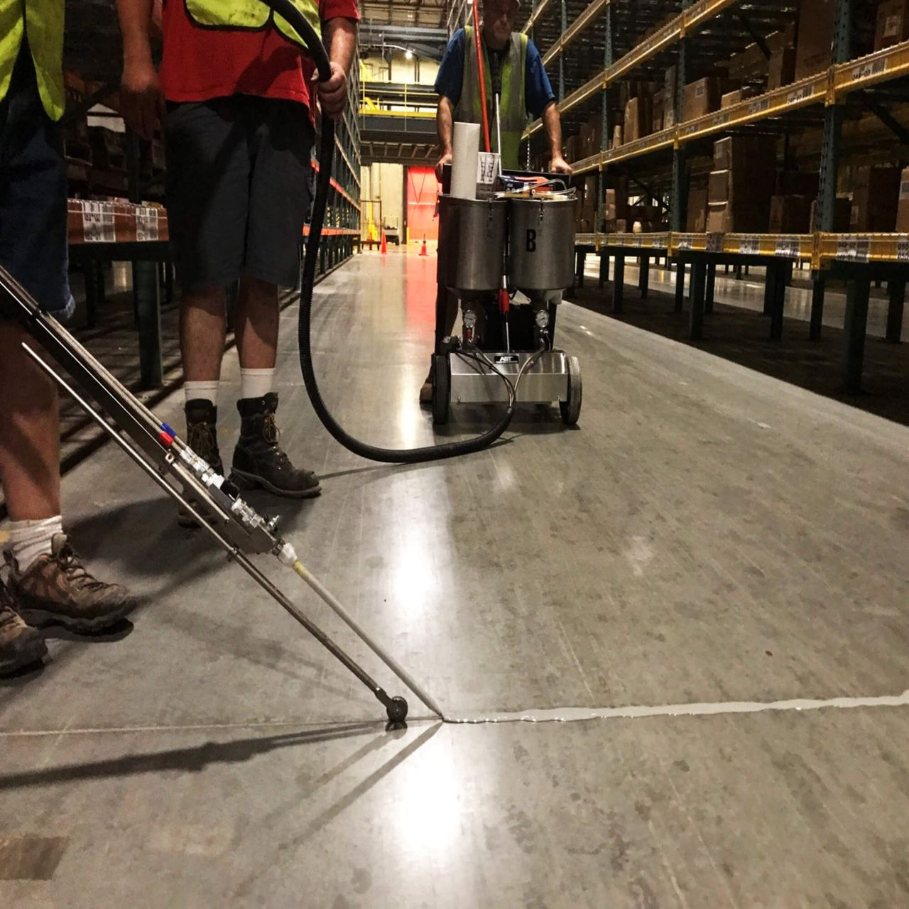 applying joint sealant in warehouse