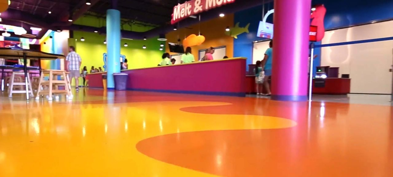 The interior of the Crayola facility showing a colorful custom-designed floor
