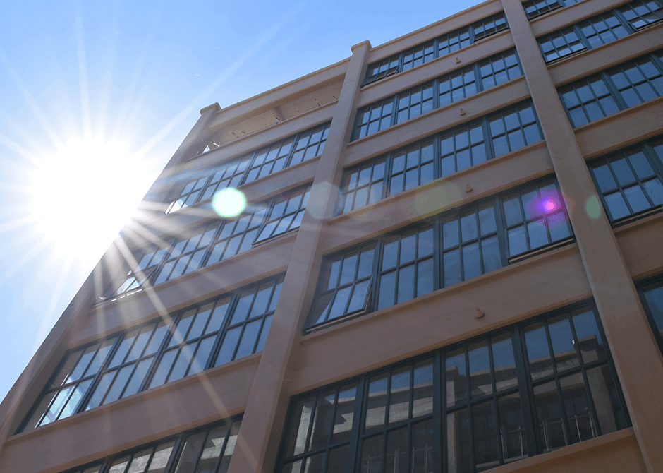 Edison Battery Building facede after restoration project with sun flare