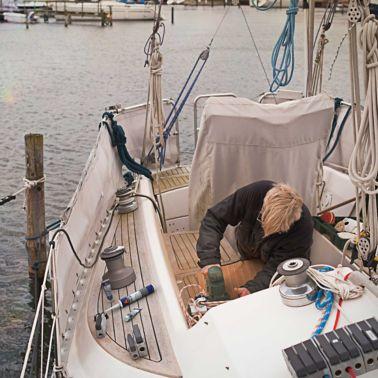 DIY Boat owner working on his boat, with Sika Marine repair products