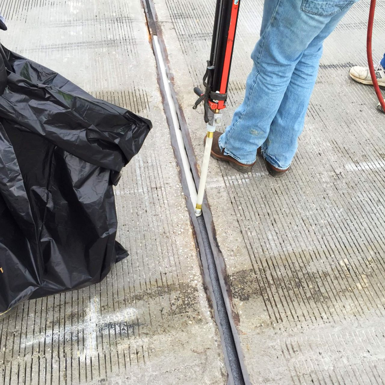 joint sealant being applied