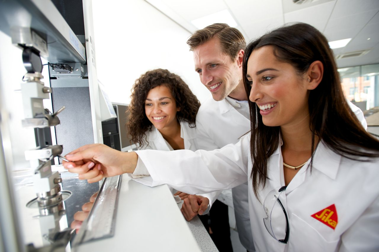 Two women and one man in a Sika USA lab