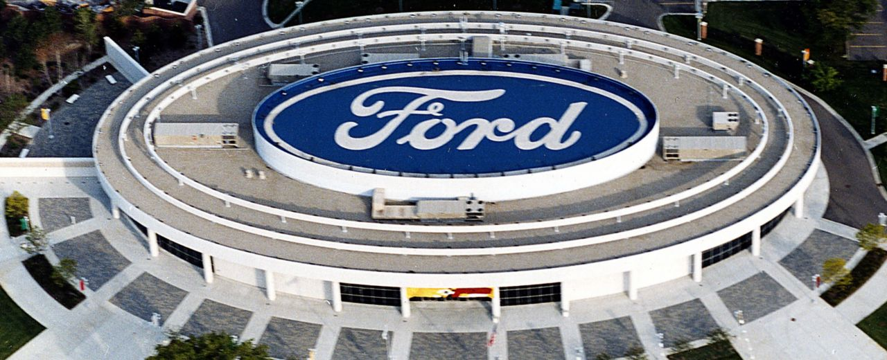 Ford factory with a ford logo on the roof