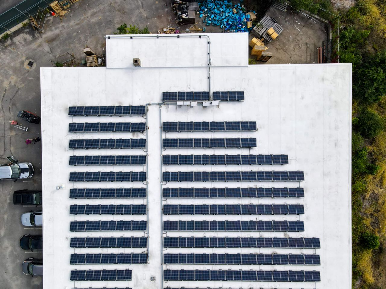 Ariel view of a white roof with solar panels