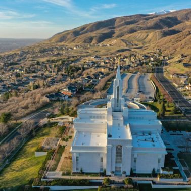 Aerial view of Bountiful Temple with a white membrane Sarnafil Roof. Mountains and residential houses can be seen in the background.