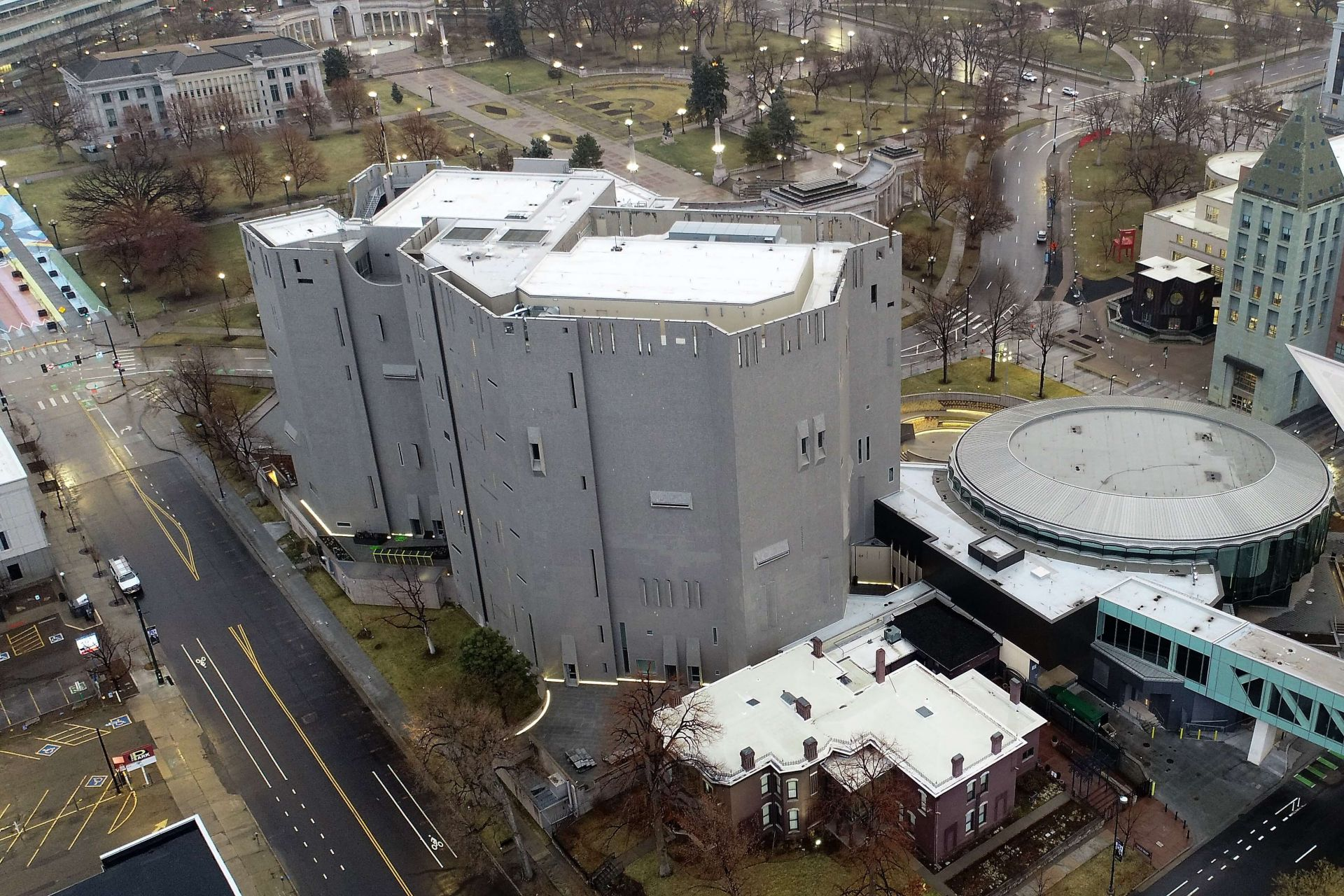 Aerial view of the Denver Art Museum showing a white Sarnafil roof overlooking the city