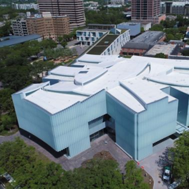 Aerial view of the Houston Museum of Fine Arts building showing a white Sarnafil roofing membrane.